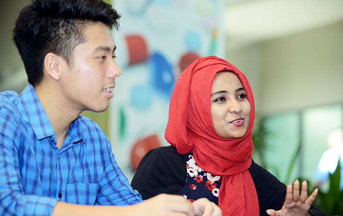 Malaysia Business Male and Female Student Studying