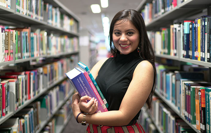 Malaysia Business Female Student Between Bookshelves